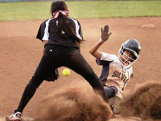Danny Udero/Sun-News   Silver's Daviana Montoya slides just under the throw during action in the second of the twin bill Friday at the Ben Altamirano Sports Complex.
