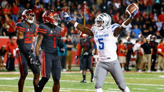 University of Memphis tight end Sean Dykes (right) celebrates a go ahead touchdown to give the Tigers a 42-38 victory over University of Houston in Houston, Texas., Thursday, October 19, 2017.