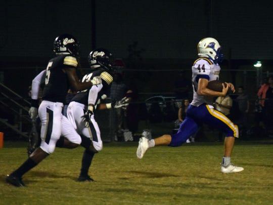 Leesville cornerback Darius Allen (5) chases down Buckeye's Justin Belgard last season.