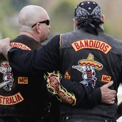 A McLennan County deputy stands guard near a group of bikers in the parking lot of a Twin Peaks restaurant in Waco, Texas.  The prevailing images of protests in Baltimore and Ferguson, Missouri, over police killings of black men were of police in riot gear, handcuffed protesters, tear gas and mass arrests. The main images of a fatal gun battle between armed bikers and police in Waco, Texas, also showed mass arrests carried out by nonchalant-looking officers.