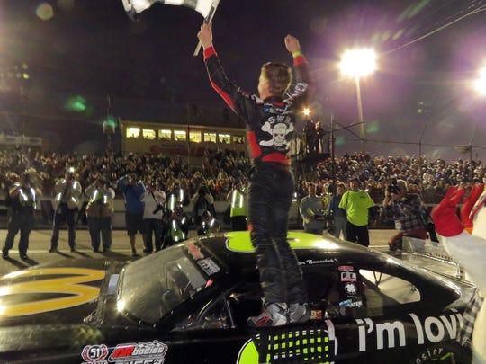 Car No. 8 driver John Hunter Nemechek waves to the crowd at Five Flags Speedway with the checkered flag he earned as winner of the 47th Snowball Derby Sunday evening at the speedway.