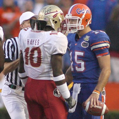 A referee moves in to separate FSU's Geno Hayes (10)
