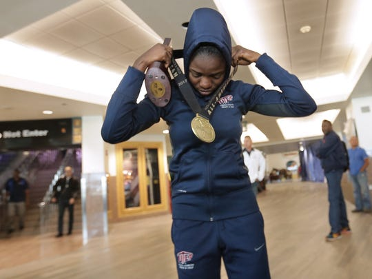 UTEP's Tobi Amusan dons her NCAA Track and Field Championship gold medal after arriving Sunday at the El Paso International Airport. Amusan won the national title in the 100-meter hurdles.
