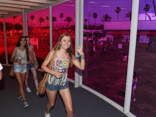 Apr 13, 2018; Indio, CA, USA; Music fans walk inside the Spectra art installation during the Coachella Valley Music and Arts Festival at Empire Polo Club. Mandatory Credit: Jay Calderon/The Desert Sun via USA TODAY NETWORK
