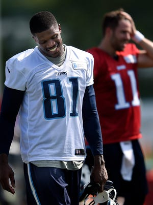Titans wide receiver Andre Johnson (81) smiles as he walks back to the huddle during the first training camp practice Saturday at St. Thomas Sports Park.