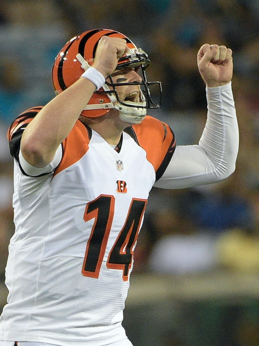 FILE - In this Aug. 28, 2016, file photo, Cincinnati Bengals quarterback Andy Dalton calls out to teammates before a play against the Jacksonville Jaguars during the first half of an NFL preseason football game in Jacksonville, Fla. The Bengals quarterback is back and feeling healthy, and ready to pick up where he left off last year after 25 touchdown passes and a career-low seven interceptions. The Bengals play at the New York Jets on Sunday. (AP Photo/Phelan M. Ebenhack, File)