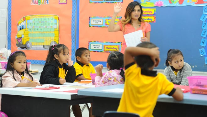 In this Aug. 18, 2014, file photo, Genine Rocco demonstrates how students should raise their hands at Chief Brodie Memorial School in Tamuning. The Legislature's education committee wants Guam Department of Education officials to justify its $324 million budget request for fiscal 2018.