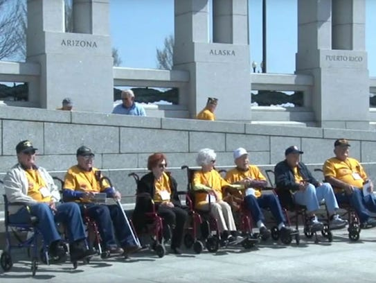 Some of the 26 Arizona  veterans who visited the World