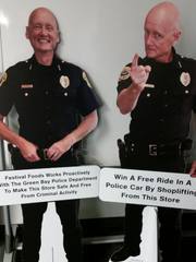 A cutout of Green Bay Police Chief warns shoppers of the partnership between the police and retailers in cracking down on shoplifting in Green Bay.
