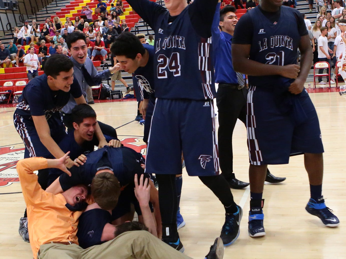 The La Quinta Blackhawks celebrate after beating rival Palm Desert Aztecs 57-50 and also win the Desert Valley League boys basketball title on Thursday, February 12, 2015 at Palm Desert.