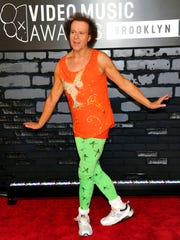 FILE - In this Aug. 25, 2013 file photo, Richard Simmons arrives at the MTV Video Music Awards in the Brooklyn borough of New York. Despite what seems to be a national obsession with the fitness guru's wellbeing, his publicist, manager, brother and two officers from the LAPD have all said the 68-year-old is at home in the Hollywood Hills and doing fine.