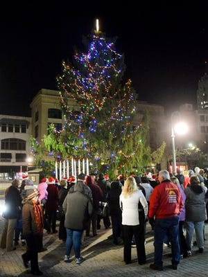 In this photo taken on Nov. 21, residents look on duing the tree lighting in Reading, Pa. Reading's spindly 50-foot spruce drew the ire of residents who said it was ruining their holiday spirit.