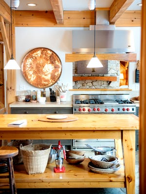 The kitchen seen inside a timber-frame home near Williamston on Friday, Feb. 16, 2018.