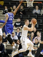 Vanderbilt's Riley LaChance, right, drives past UNC-Asheville's Raekwon Miller, left, during the first half in Nashville, Friday, Nov. 17, 2017.