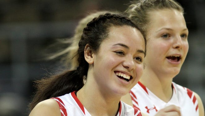 Dixie Heights' Sydney Lockard smiles after the Colonels win at the Ninth Region tournament over Newport Central Catholic Tuesday, Feb. 27, 2018.