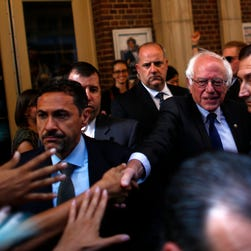 Democratic Presidential candidate Bernie Sanders shakes hands with supporters in New York on June 23, 2016.