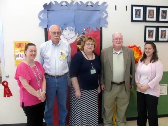 From left are Teacher Jamie Mulhollen, Volunteer Howard Powell, Principal Pamela Smith, Volunteer Larry Coghlan and Teacher Jobie Bolden.