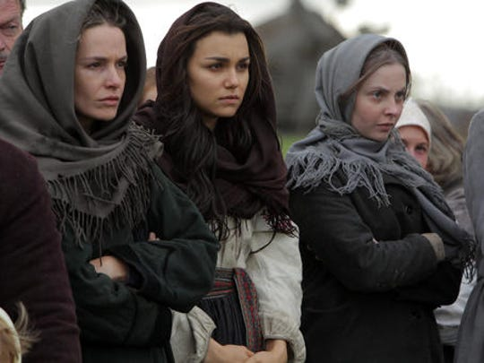 "This image released by Roadside Attractions shows Valeria Hodos, from left, Samantha Barks and Lucy Brown in a scene from, ""Bitter Harvest."""