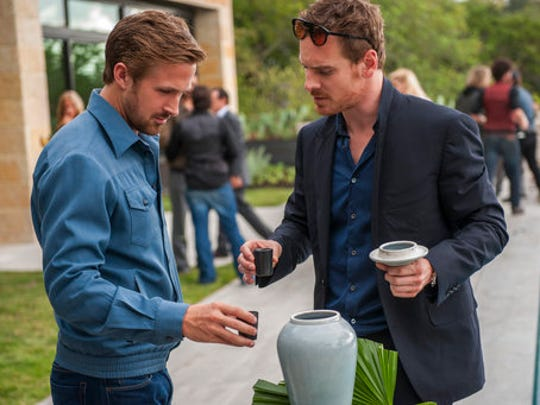 "This image released by Broad Green Pictures shows Ryan Gosling, left, and Michael Fassbender in a scene from, ""Song to Song."""