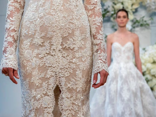 In this April 21, 2017 photo, the Monique Lhuillier bridal collection is modeled during bridal fashion week in New York.