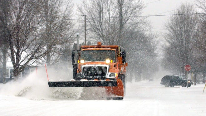 Road crews work to plow snow in Stevens Point in this 2005 file photo.