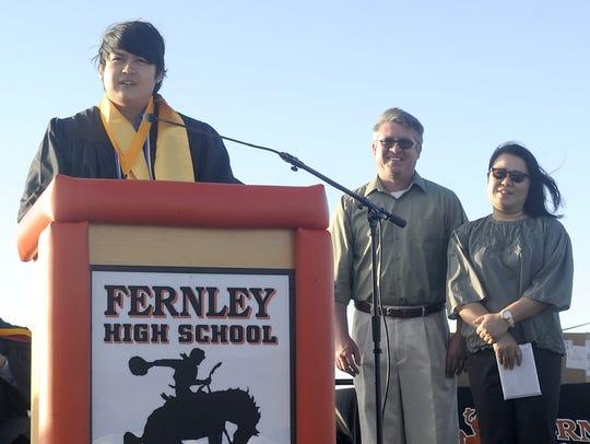 Salutatorian Eric Wootton gives a speech as his parents