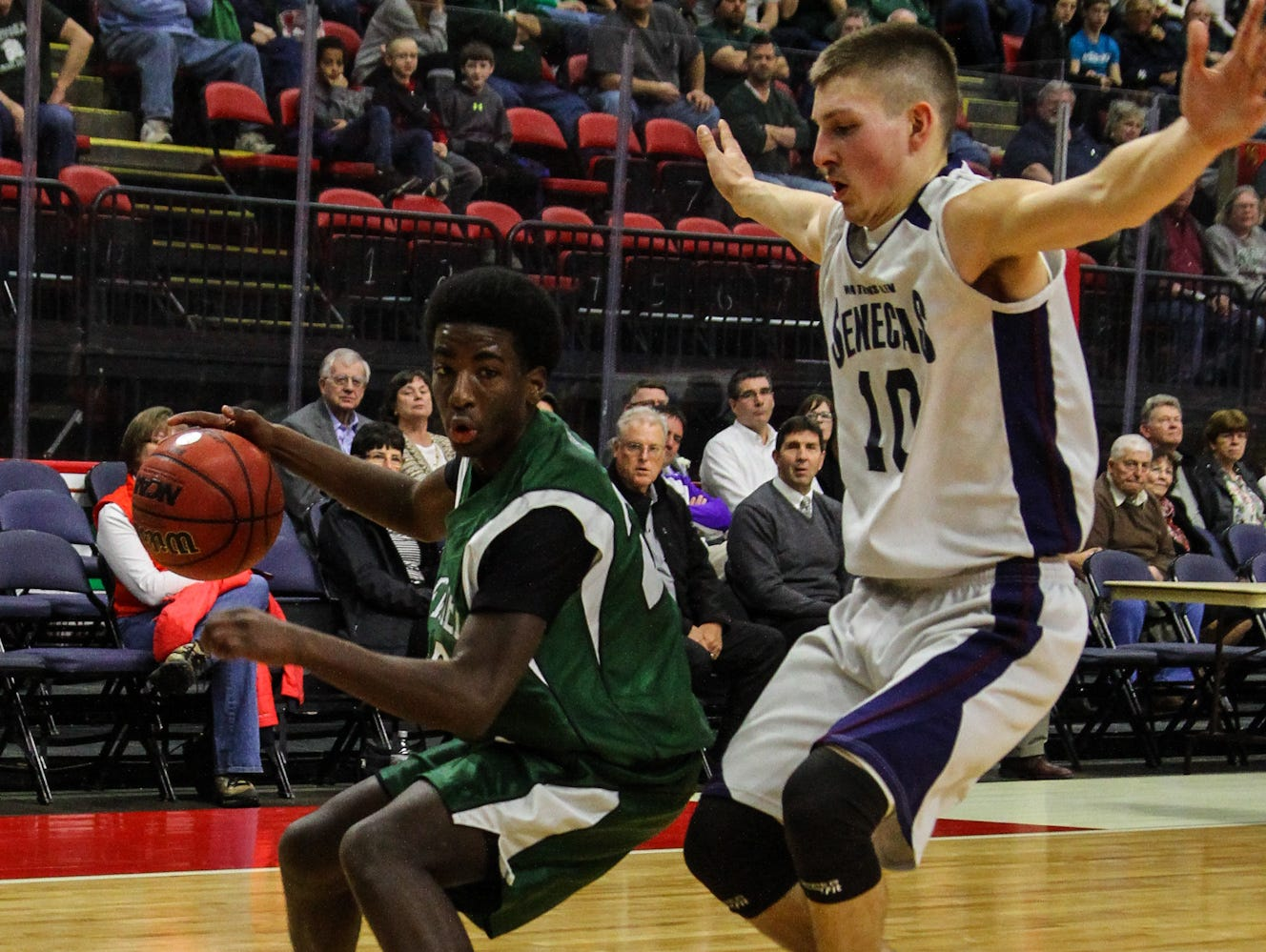Newfield senior point guard Brian Barrett, shown in action last week against Watkins Glen at the Section 4 Class C title game in Binghamton, leads the Trojans in scoring at 15 points per game. Newfield meets top-ranked Waterville in the state Class C quarterfinals on Saturday in Oneonta.
