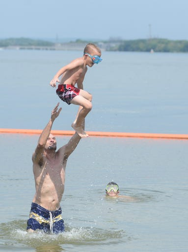 Matthew and Evan Demonbreun have fun in the sun as Jordan Murphy looks on in Old Hickory Lake at the Lock 3 Recreation Area in Hendersonville on Saturday, Aug. 23.