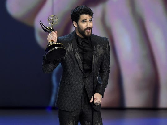 """Darren Criss accepts the award for outstanding lead actor in a limited series, movie or dramatic special for """"The Assassination of Gianni Versace: American Crime Story"""" at the 70th Primetime Emmy Awards on Monday, Sept. 17, 2018, at the Microsoft Theater in Los Angeles. (Photo by Chris Pizzello/Invision/AP)"""