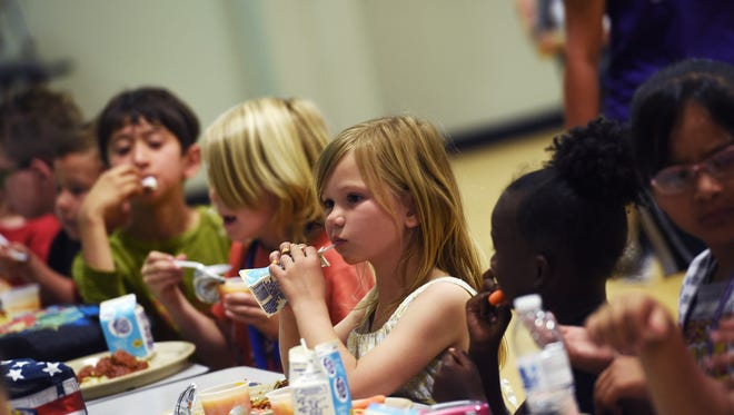 Children eat lunch at the Boys and Girls Club of Truckee Meadows as part if the U.S. Department of Agriculture Summer Food Service Program.
