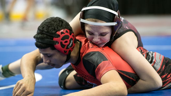 Gettysburg's Montana DeLawder, top, wrestles Reading's Esteven Muniz during a 106-pound bout, at the District 3 Class 3A wrestling tournament at the Giant Center in Hershey, Thursday, Feb. 22, 2018.