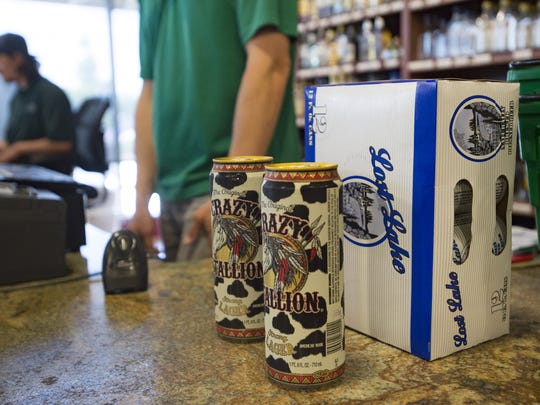 Varieties of beer are purchased at Bullfrog Wine and Spirits on N. College Avenue on Thursday, July 27, 2017.