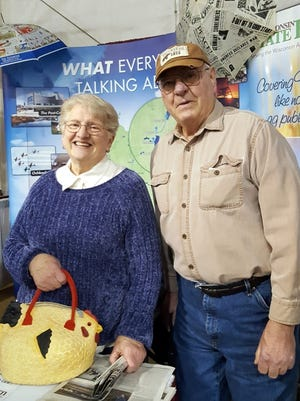 Columnist Susan Manzke brought along her chicken purse - and husband, Bob, to the WPS Farm Show where they greeted readers at the Wisconsin State Farmer booth.