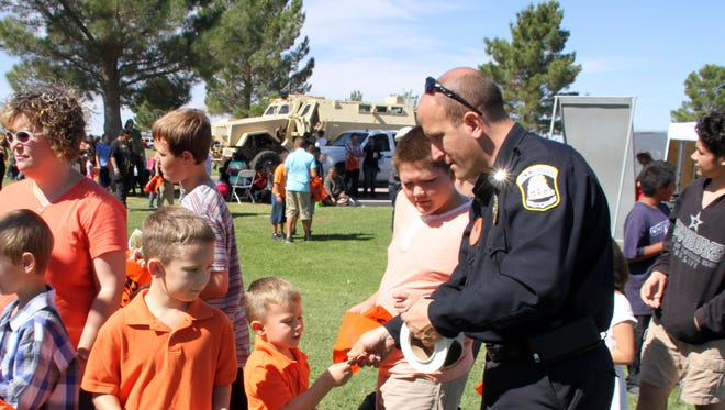 Deming Police Chief Bobby Orosco handed out badges to youngsters during one of many community events the PD participates in.