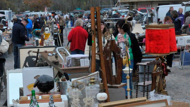 Shopping browsing through the merchandise at Golden Nugget Antique Market in Lamberville, N.J.