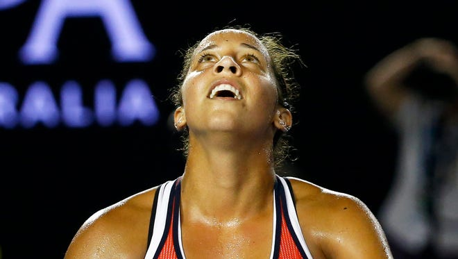Madison Keys of the USA reacts after defeating Ana Ivanovic of Serbia in their third round match at the Australian Open in Melbourne, Jan. 23,  2016.