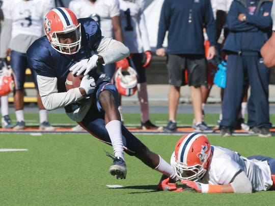 Receiver Tyler Batson tried unsuccessfully to escape