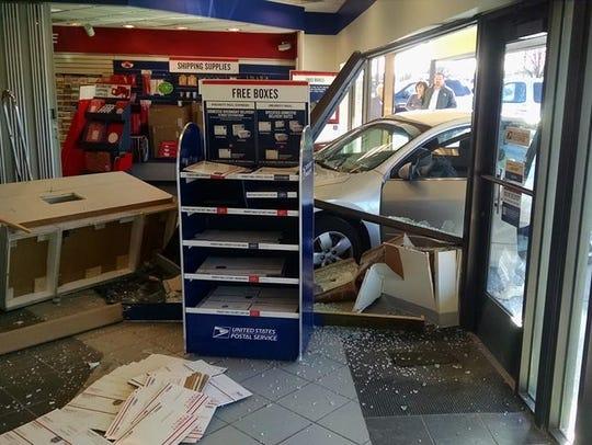 A Washington Township woman's car smashed through storefront