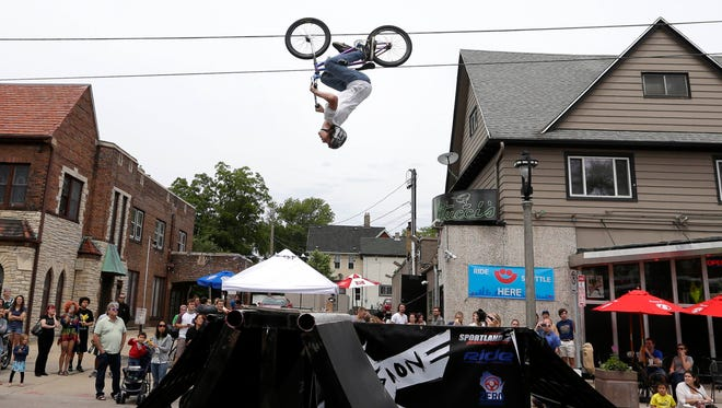 BMX stunt bikers take to the track (and the air) during Summer Soulstice Music Festival on Milwaukeee's east side.