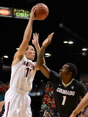March 14, 2014 - Wildcats forward Aaron Gordon (11) shoots against Colorado Buffaloes forward Wesley Gordon (1) during the first half in the semifinals of the Pac-12 Conference college basketball tournament at MGM Grand Garden Arena.