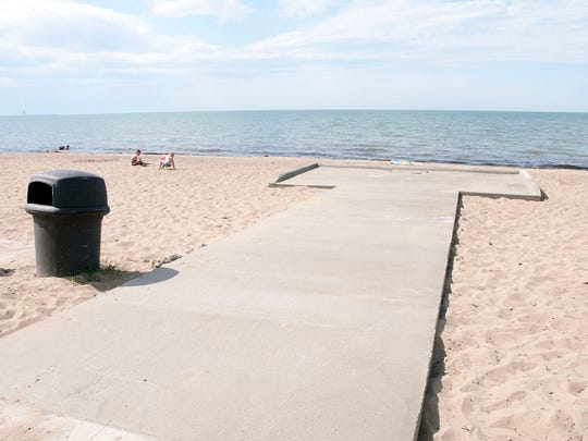 Holcomb Enterprises donated the material and services to build a new wheelchair pad at the Port Clinton City Beach.