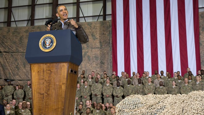 This May 25, 2014, file photo shows President Barack Obama speaking during a troop rally after arriving at Bagram Air Field for an unannounced visit, north of Kabul, Afghanistan.