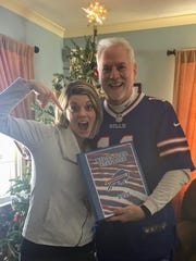 Dick DeGroat, right, poses his daughter Olivia Morgante and a Bills-themed gift she gave him this Christmas.