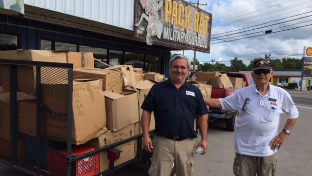 Barry Coate left, and his father David Coate, wrap up business at Pack Rat Military Surplus.