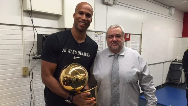 Richard Jefferson stands with the Larry O'Brien Trophy at Moon Valley High School with his high school coach John Boie on Sept. 23, 2016.