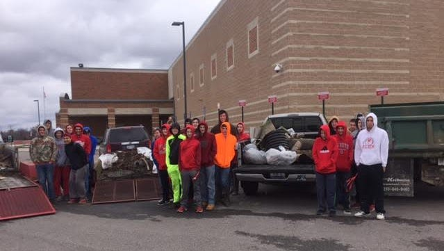 Elgin boys basketball players braved cold conditions and snow flurries to remove roughly three truckloads of debris from the new section of trail.