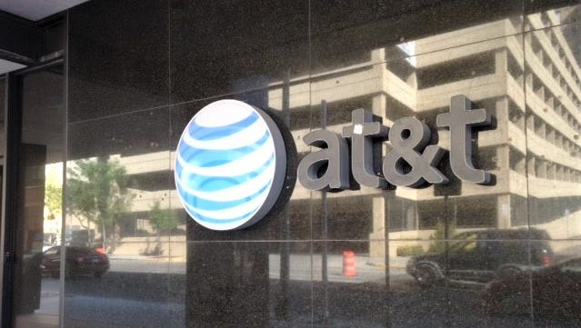 AT&T's corporate logo is on its Downtown El Paso facility. The company is closing its East El Paso call center by the end of the year.