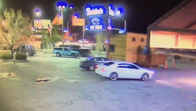 Sparks police investigators released a surveillance photo showing a white car with chrome wheels parked at Baldini's Casino during a robbery March 21, 2018.