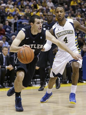 Butler's Alex Barlow, left, drives against Marquette's Todd Mayo (4) during the second half of an NCAA college basketball game, Tuesday, Feb. 4, 2014, in Milwaukee. (AP Photo/Jeffrey Phelps)