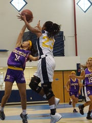Janiko Gogue, left, battled Britney Bailey in the low post to help lead the George Washington Geckos to a 48-45 IIAAG Girls' Basketball League win at the Guam High Panthers on Saturday, Nov. 5.